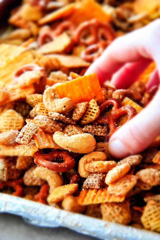 Make ahead crunchy, salty, savory Italian Parmesan Party Mix bursting with Italian flavor in each cashew, pretzel, chex mix bite! This is my go-to party snack that everyone begs me to make!
