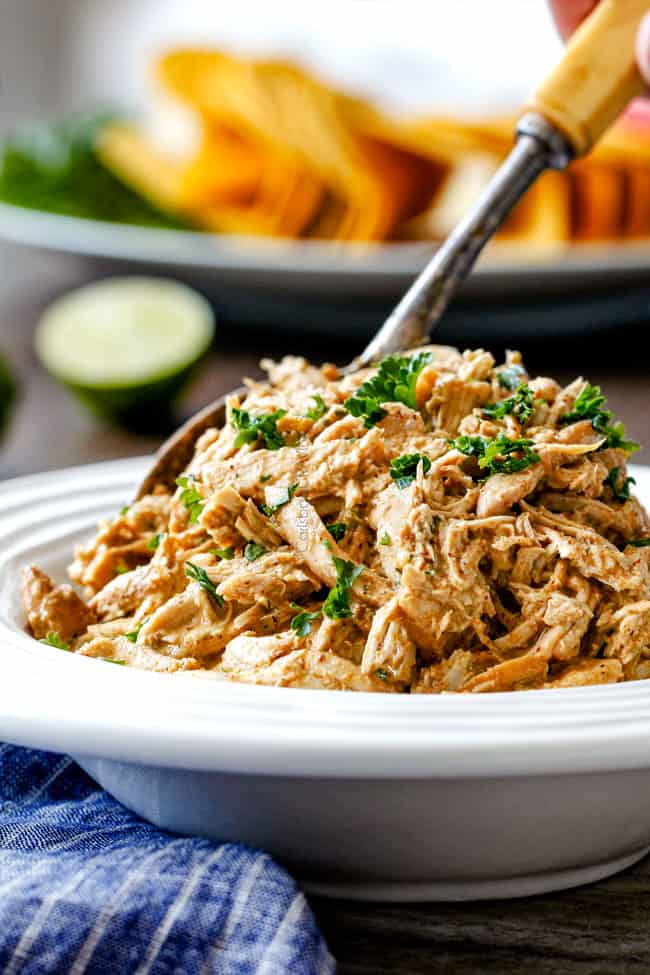 slow cooker cream cheese chicken in a white bowl