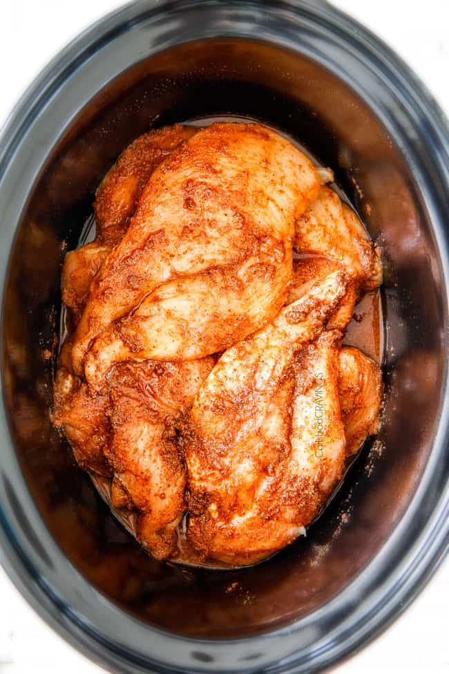 showing how to make Cream Cheese Chicken by adding chicken to crockpot