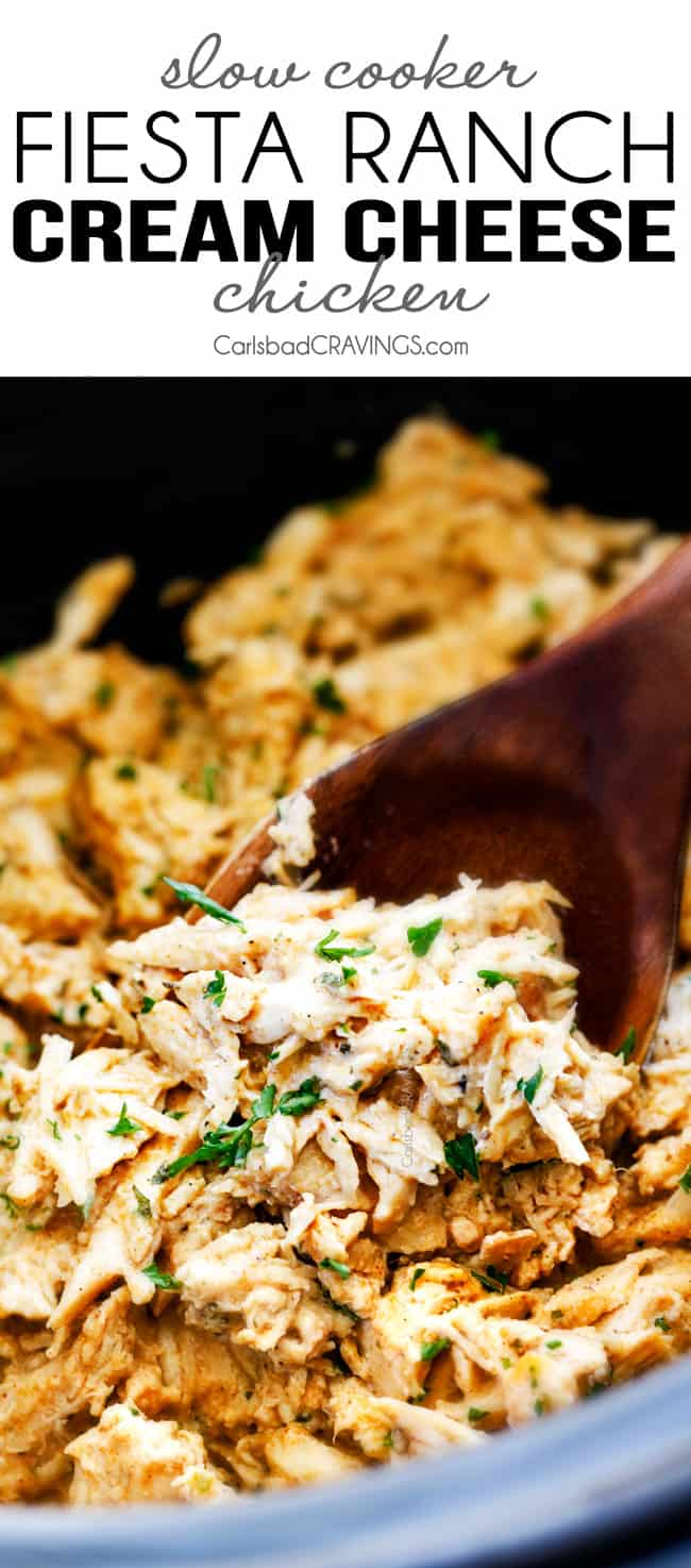 up close of a wooden spoon scooping up crockpot cream cheese chicken
