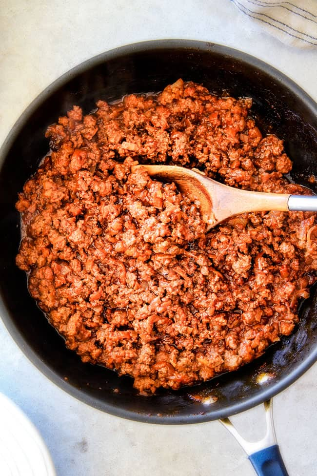 showing how to make sloppy Joes by simmering filling in a skillet