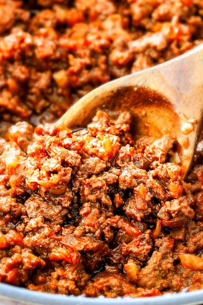 showing how to make sloppy Joes by stirring saucy beef filling