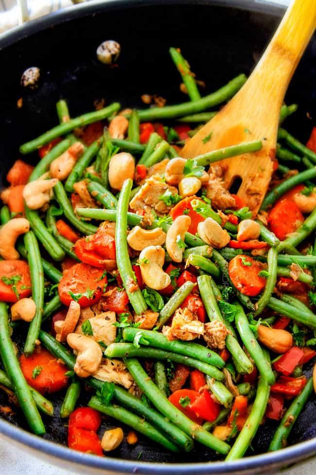 Tuna Veggie Bowls adding cashews.