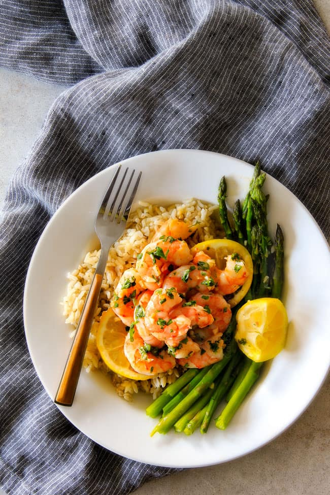 One Pan Roasted Lemon Butter Garlic Shrimp and Asparagus bursting with flavor and on your table in 15 MINUTES!  No joke!  The easiest, most satisfying meal that tastes totally gourmet!