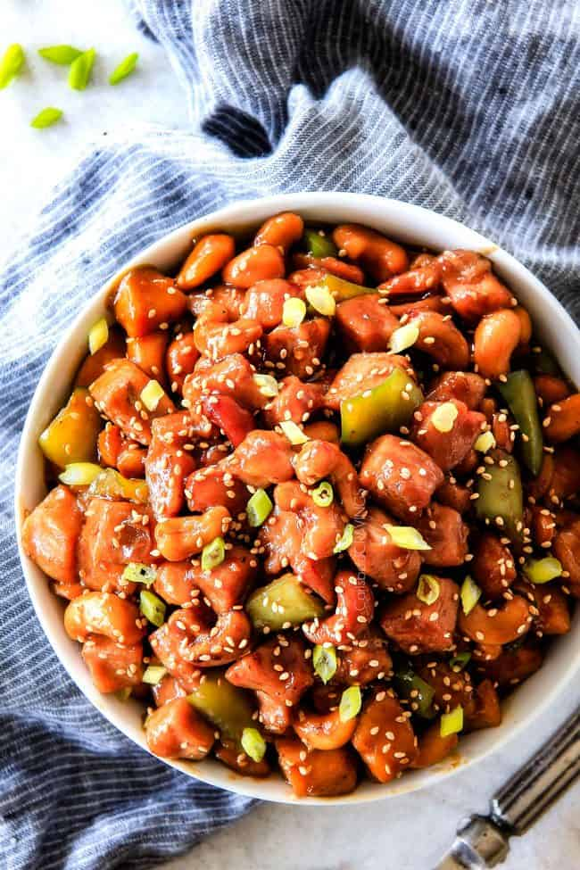 Slow Cooker Chinese Cashew Chicken- this is the best cashew chicken I have ever tried! the chicken is incredibly tender, the sauce is wonderfully flavorful and the punch of buttery, creamy cashews is out of this world! Definitely a family favorite and so much heather than takeout!