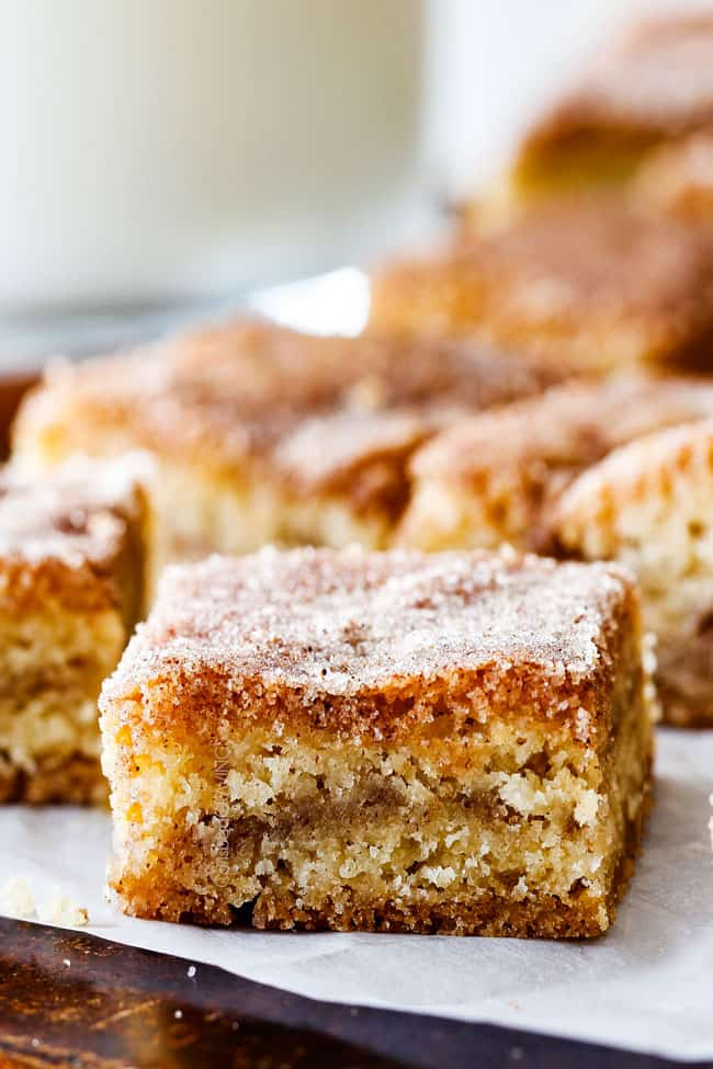 Incredibly EASY, thick, soft and chewy, buttery Snickerdoodle Cookie Bars taste just like the cookie but so much easier and less time consuming! The cinnamon and sugar crackle top is to die for!