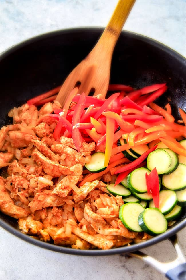 Showing how to make Thai Red Curry Chicken sauteing in a pan.