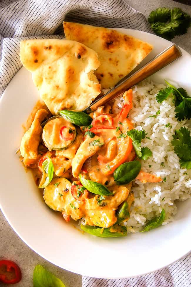 Thai Red Curry Chicken with rice on a plate.