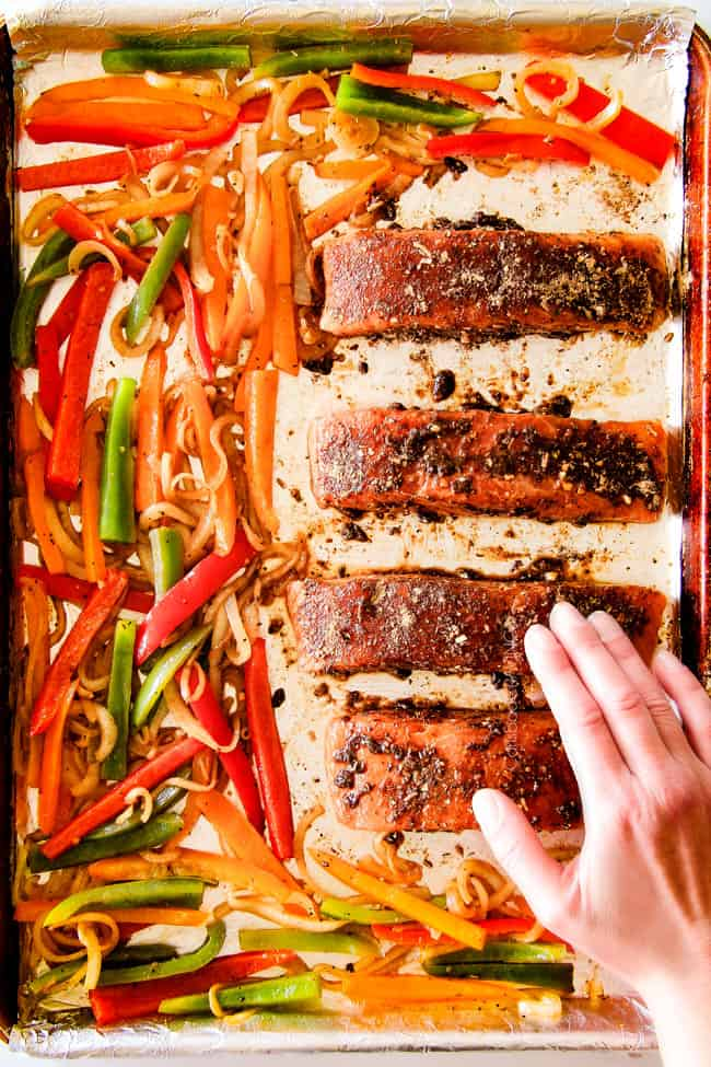 Showing how to make Sheet Pan Fajita Salmon with Cilantro Lime Butter by baking all ingredients on a sheet pan.