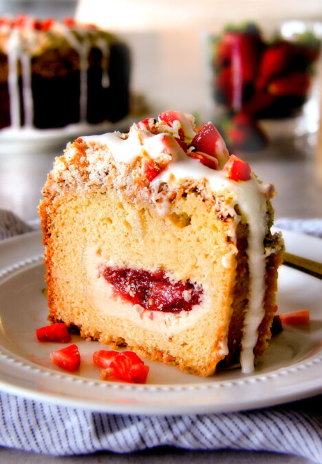Strawberry Cream Cheese STUFFED Sour Cream Coffee Cake - this is the best strawberry coffee cake ever! the INCREDIBLY creamy cheesecake-like cream cheese filling and strawberries all topped with Coconut Pecan Streusel and Lemon Drizzle is OUT OF THIS WORLD! I can't say enough good things about this coffee cake!