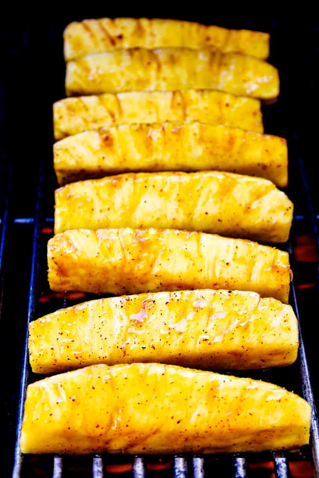 showing how to make grilled pineapple by grilling on a grill