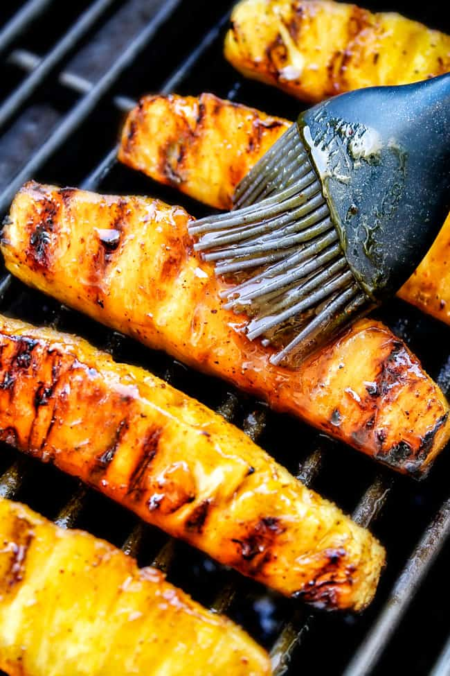 the BEST Caramelized Grilled Pineapple glazed with the moist irresistible buttery, tangy Brown Sugar Chili Glaze! You will never want to eat pineapple any other way again! Serve it as an easy appetizer, side or even dessert all summer long!