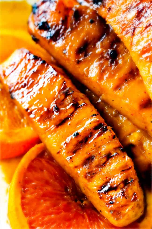 the BEST Caramelized Grilled Pineapple smothered with the moist irresistible buttery, sweet, tangy Brown Sugar Orange Glaze! You will never want to eat pineapple any other way again! Serve it as an easy appetizer, side or even dessert all summer long!
