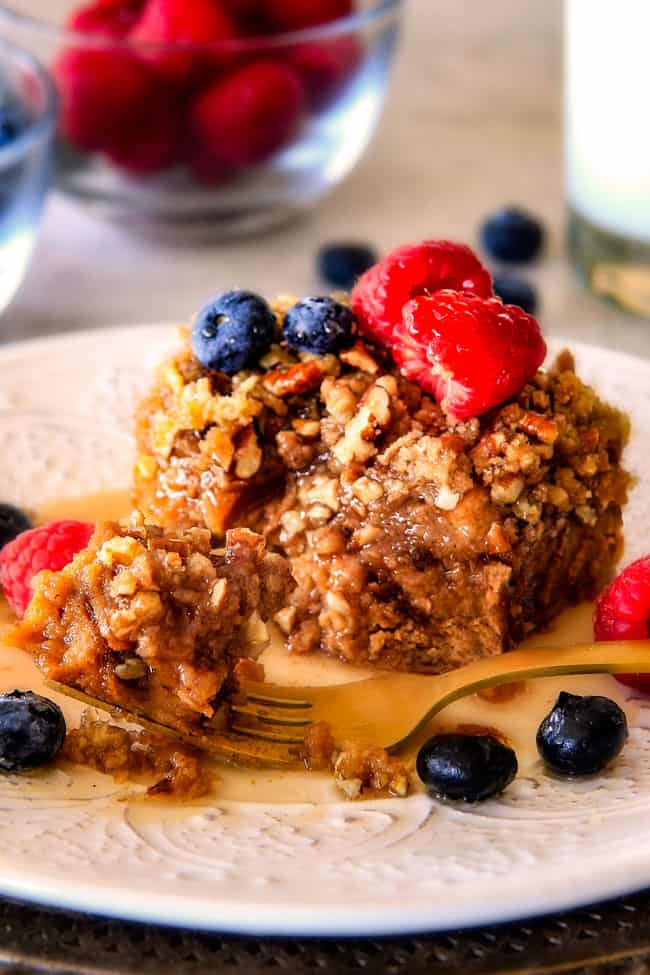 a forkful of Easy French Toast Casserole recipe on a white plate