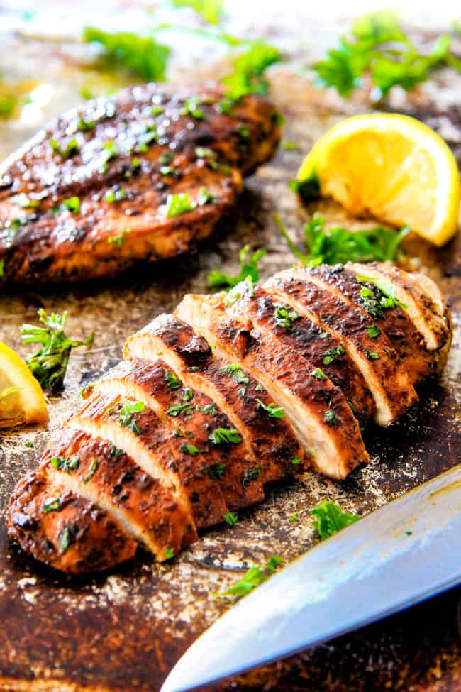 Sliced Greek Chicken Marinade on chicken.