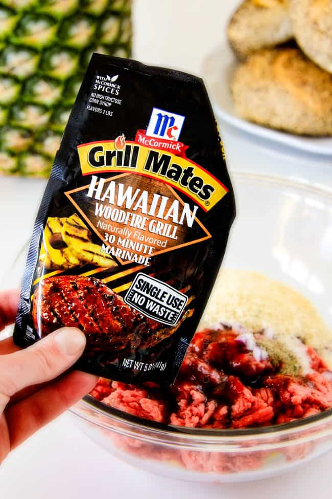 showing how to make Hawaiian Burgers by adding the meat and seasonings to a glass bowl