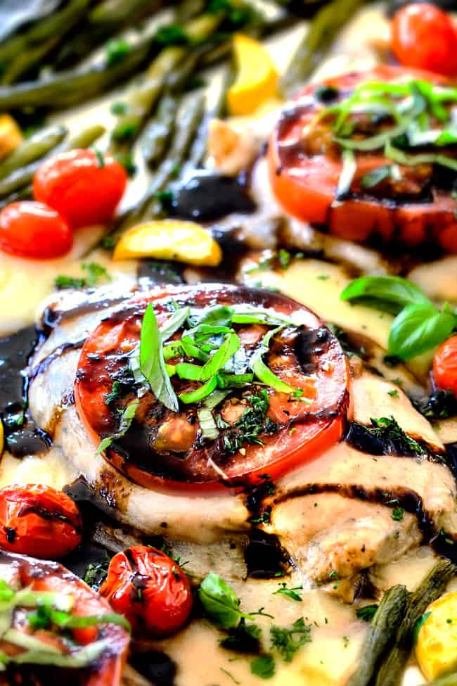 Sheet Pan Caprese Chicken and Veggies - an easy, satisfying meal all in one! Wonderfully juicy, flavor bursting chicken smothered in gooey mozzarella cheese with fresh basil and the most incredible balsamic reduction!