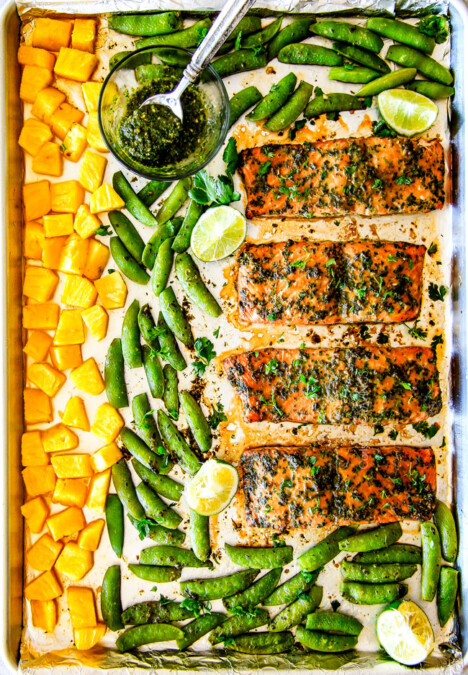Easy SHEET PAN Asian Chimichurri Salmon is the most tender, flavorful salmon you will ever make - no joke! all cooked with pineapple and snap peas for a complete meal-in-one! An easy, satisfying dinner that tastes totally gourmet!