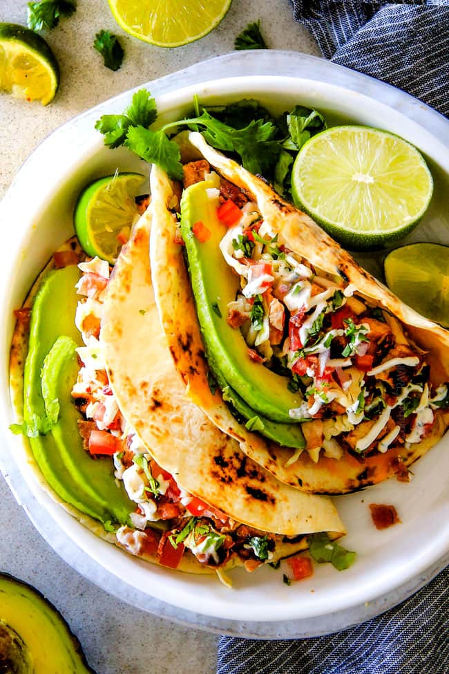 These are ADDICTINGLY DELICIOUS!  Honey Chipotle Chicken Tacos stuffed with wonderfully juicy, flavor packed Honey Chipotle Bacon Chicken (yes BACON chicken!), piled with crispy BLT Slaw and creamified with Cilantro Lime Crema!