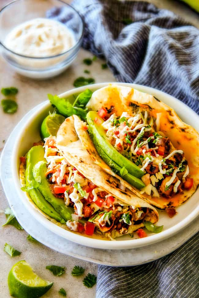 These are ADDICTINGLY DELICIOUS! Honey Chipotle Chicken Tacosstuffed with wonderfully juicy, flavor packed Honey Chipotle Bacon Chicken (yes BACON chicken!), piled with crispy BLT Slaw and creamified with Cilantro Lime Crema!