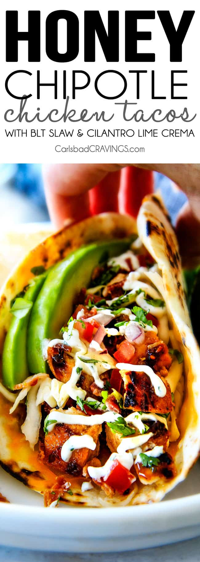 up close of Chipotle Chicken Tacos piled with honey chipotle chicken, tomatoes and avocados