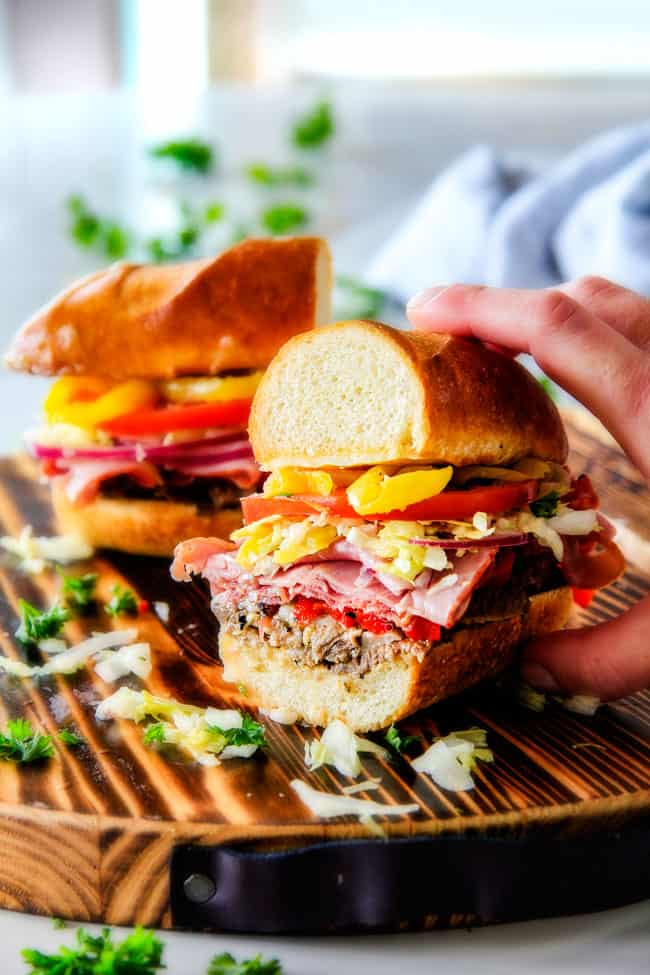 Easy, customizable LOADED Slow Cooker Italian Beef Sandwiches are crazy tender, seeping with flavor and unbelievably delicious! They make the easiest dinner or party food and super fun (make ahead!) sandwich bar!