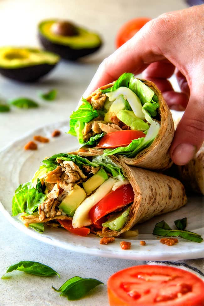 15 MINUTE Avocado Caprese Chicken Wraps  - I am completely addicted to these wraps and they are totally easy and healthy! they are loaded with the most amazing balsamic chicken, juicy tomatoes, milky mozzarella, creamy avocadoes, crunchy romaine, fresh basil and crispy bacon all wrapped in a soft flatbread.  seriously, to die for!