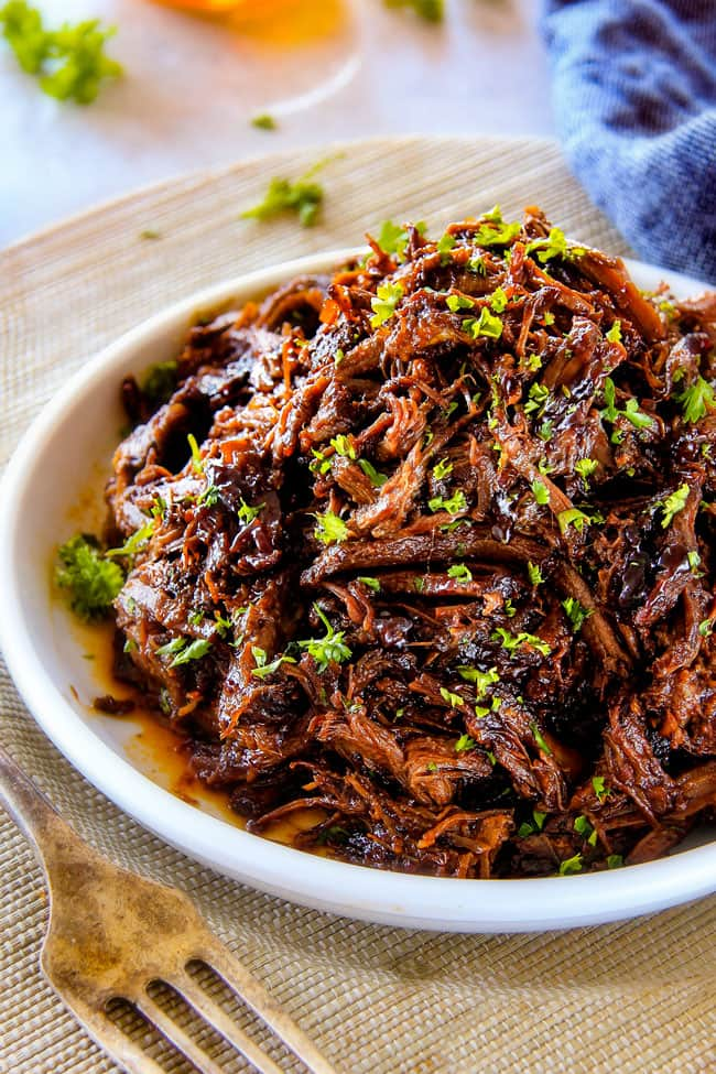 I am obsessed with this sweet and tangy, savory Slow Cooker Honey Balsamic Beef!!! It's fall apart tender, crazy juicy, packed with flavor and smothered in the most AMAZING honey balsamic sauce! perfect for sandwiches or stand alone delicious with rice and potatoes!