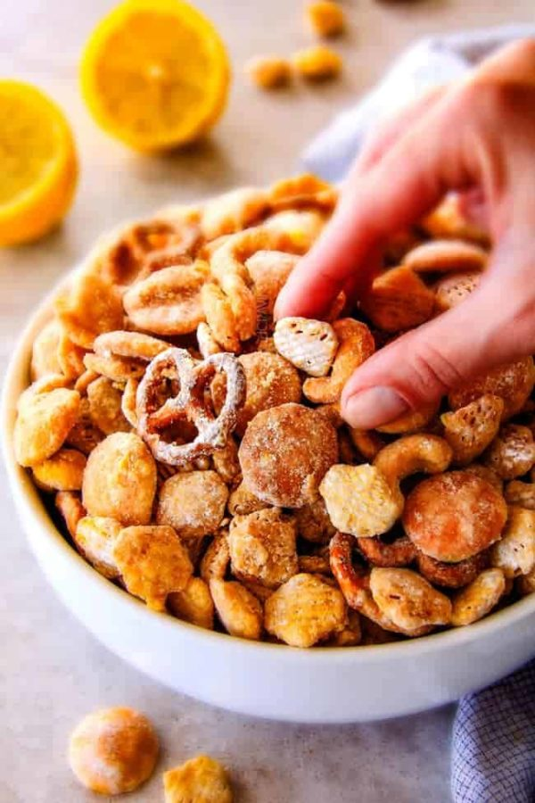 Everyone begs me to bring this seriously addicting Lemon Snack Mix to every party and get together!   Its super easy, make ahead,  sweet and tangy and coated in AMAZING White Chocolate Lemon Glaze!  Your friends will love it!