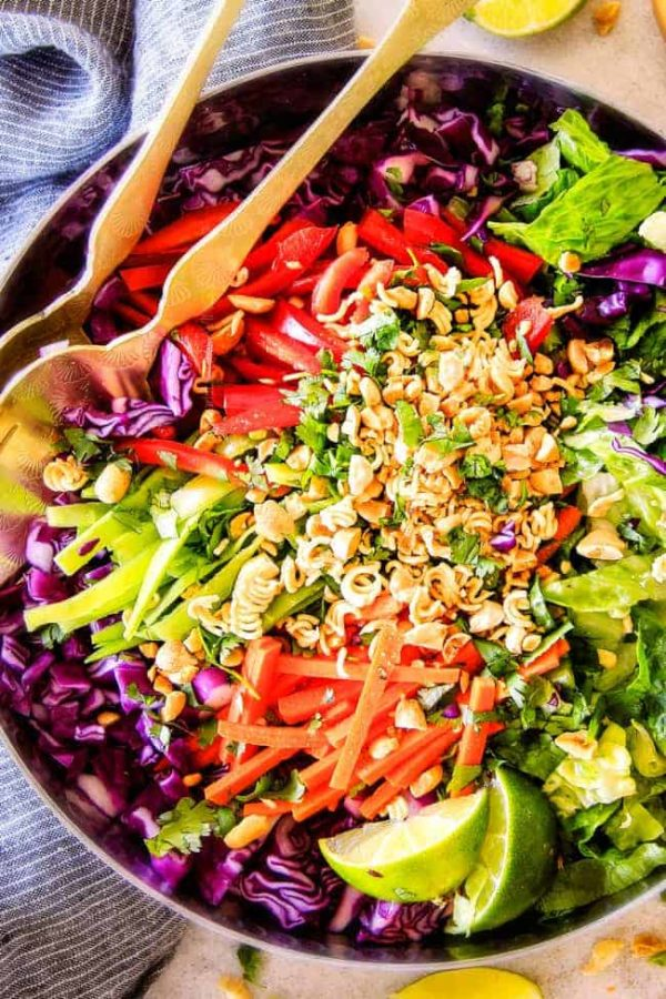 This Crunchy Asian Salad with Sriracha peanut Dressing is CRAZY GOOD!   The combination of texures is amazing and the dressing is absolutely addicting!  This salad is so good I was actually eating leftovers for breakfast!