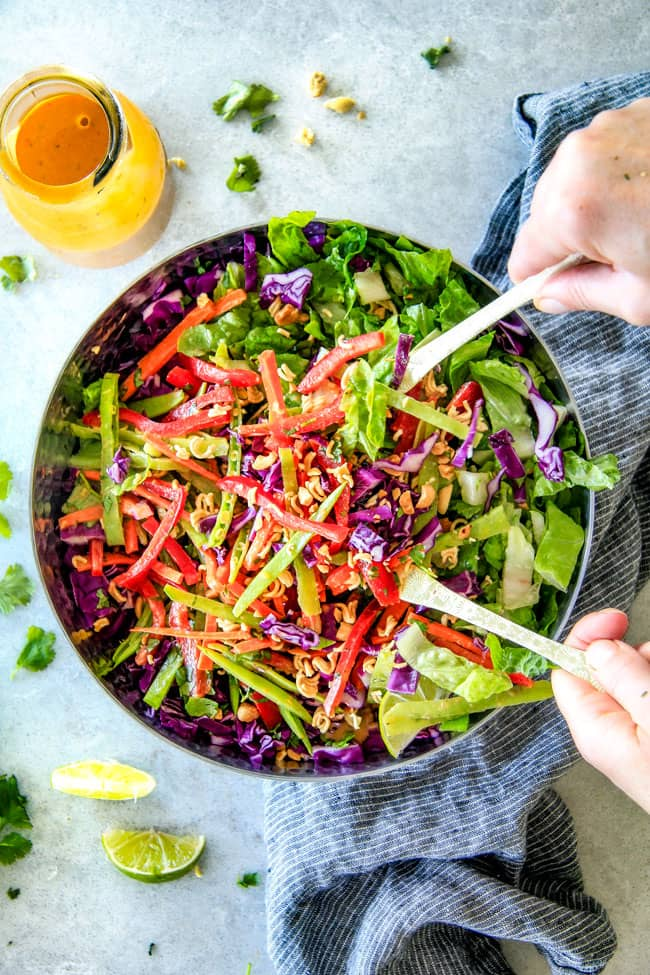Serving Crunchy Asian Salad with Sriracha Peanut Dressing.