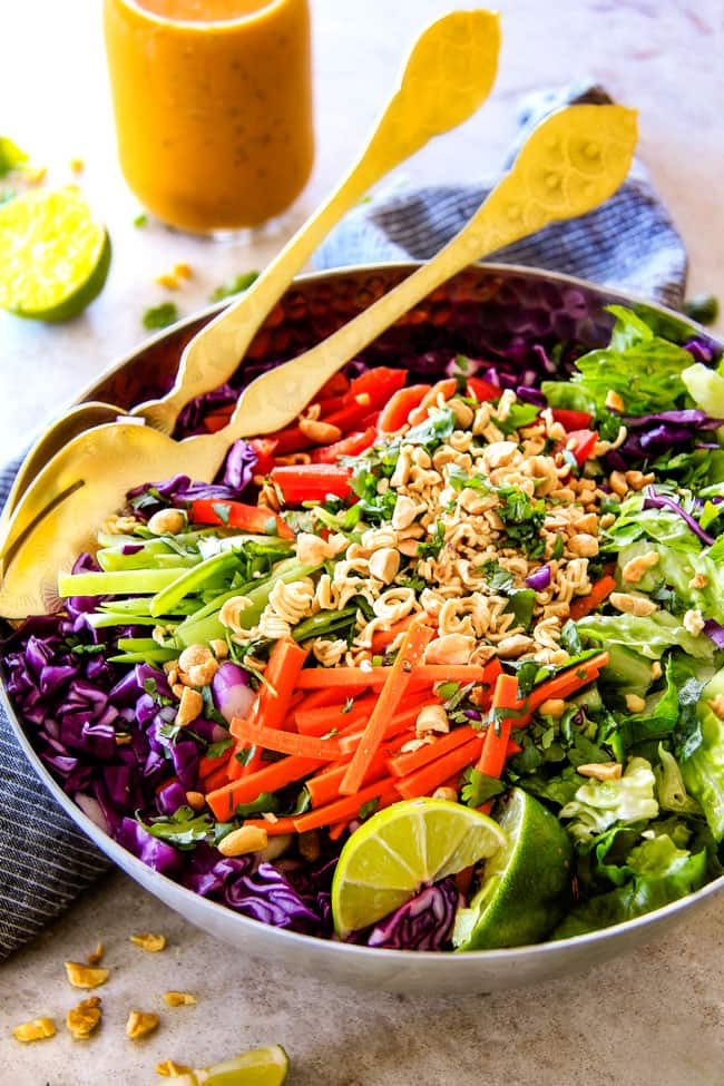 Crunchy Asian Salad with Sriracha Peanut Dressing with limes.