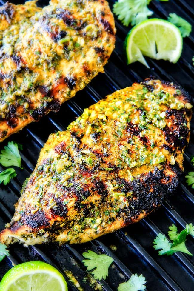 Easy, juicy, flavorful Cilantro Lime Chicken seeping with flavor is a meal in itself orinstantly transforms salads, tacos, burritos, wraps, etc into the most epic meal EVER! I love having this chicken on hand!