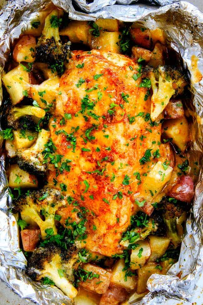 EASY Baked or Grilled Cheesy Buffalo Chicken Foil Packets bursting with juicy chicken and tender, flavorful veggies all smothered in cheddar and dipped in Ranch Crema! these are SO addictingly delicious!!!