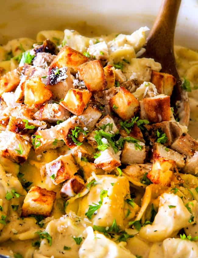 This Creamy Caesar Chicken Tortellini is SO addicting!  My family raved about it for days!   Its  wonderfully cheesy, garlicky, lemony, & perfect with tortellini and juicy chicken!  I will be using the chicken marinade just plain too its so good!
