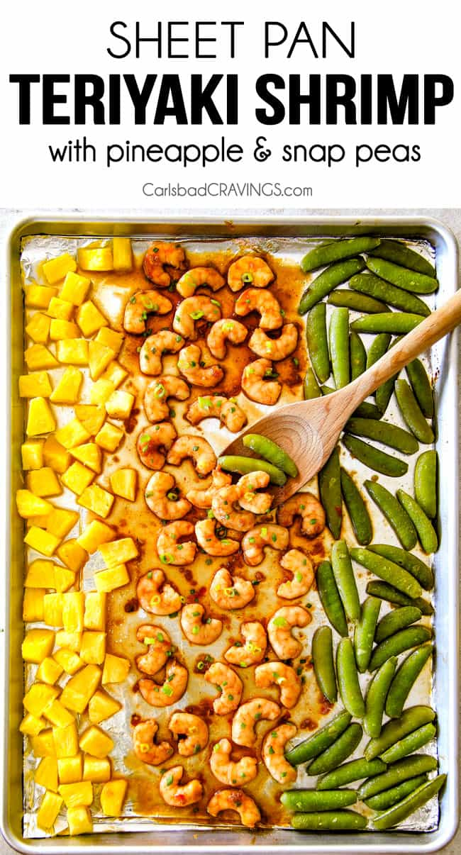 top view of teriyaki shrimp on a sheet pan with pineapple and snow peas.