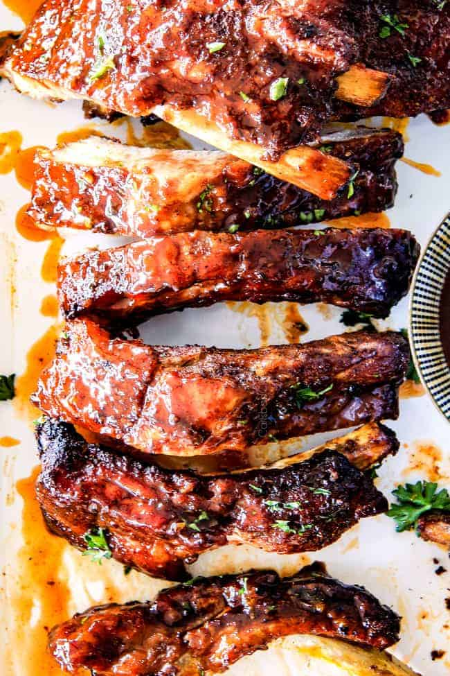 15 minute prep Fall-Off-the-Bone Slow Cooker HONEY BUFFALO Ribs that everyone goes crazy for! These are SO tender and SO easy! They are slathered in an amazing rub and the most addicting honey buffalo sauce ever!