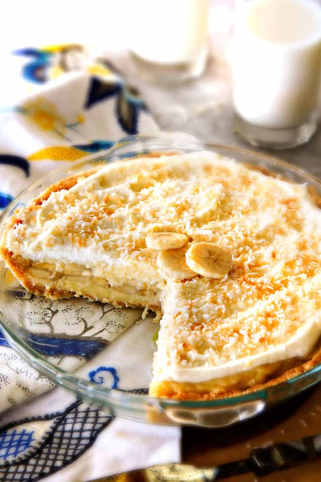This Banana Coconut Cream Pie is absolutely AMAZING!  Its the best ever banana pie and coconut cream pie mashed together nestled in an easy, Vanilla Wafer Coconut Crust and topped with COCONUT whipped cream!  #thanksgiving #easter