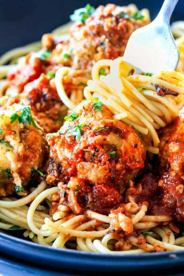 Easy, juicy, flavorful Italian meatballs bathed in rich marinara, smothered in mozzarella and Parmesan and baked to golden cheesy deliciousness! This is one of my favorite recipes EVER and they make the BESTspaghetti and meatballs!
