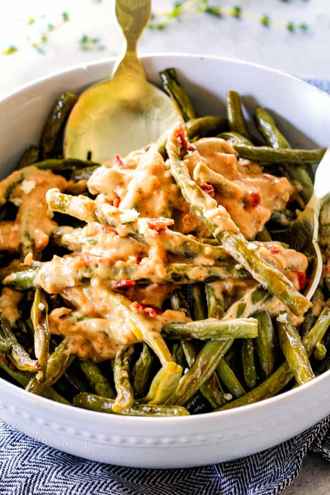 up close of the best oven roasted green beans in a white bowl