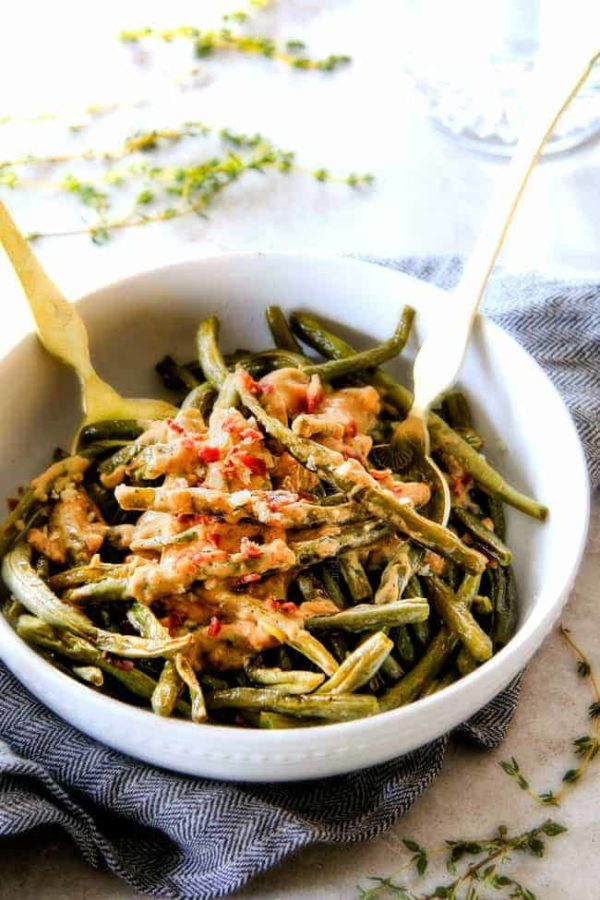 Forget green bean casserole, these wonderfully flavorful, crisp tender Roasted Green Beans with Creamy Gruyere Sauce are AMAZING!!!  They the best green beans you will ever eat!   They are easy enough for every day but delicious enough for special occasions (like Thanksgiving, Christmas!)!