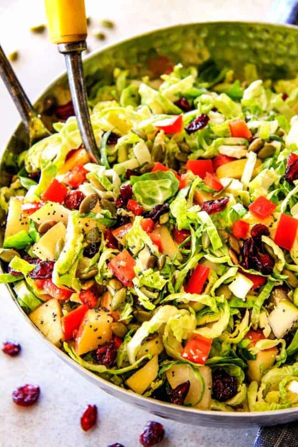 Cranberry Apple Shaved Brussels Sprouts Salad with Lemon Poppy Seed Dressing is one of my favorite salads IN THE WORLD! It belongs on your table this Thanksgiving and Christmas and all season long!  The perfect STRESS FREE make ahead side that is flavor and texture heaven!  #thanksgivingside #thanksgivingsalad