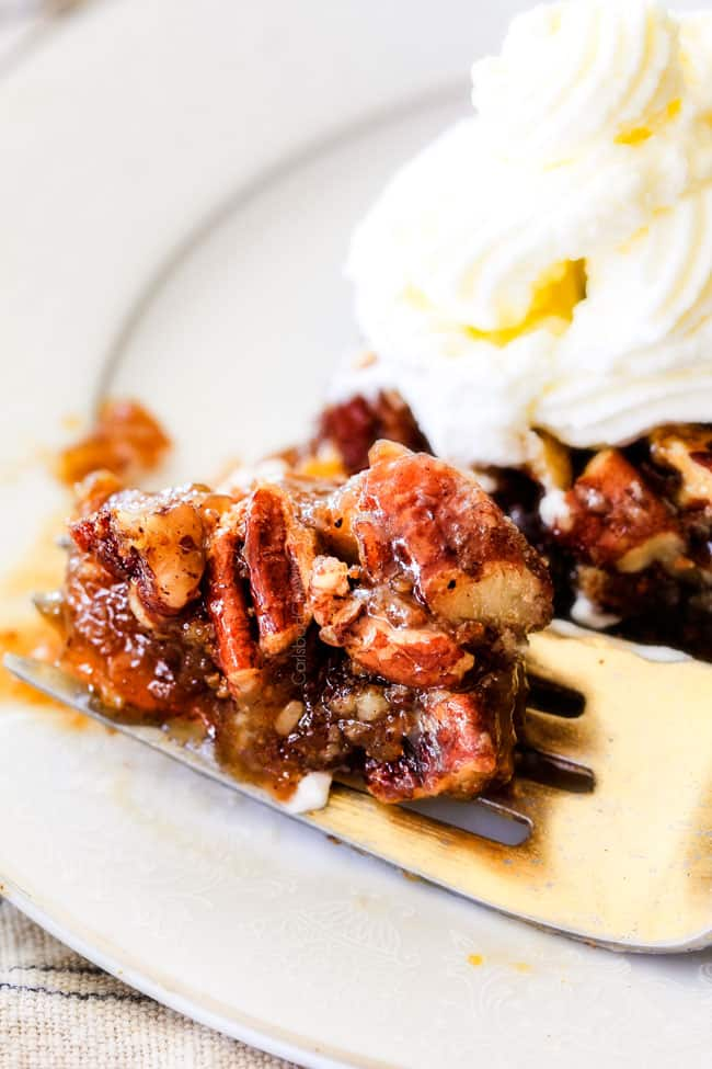 close up of forkful of the best pecan pie