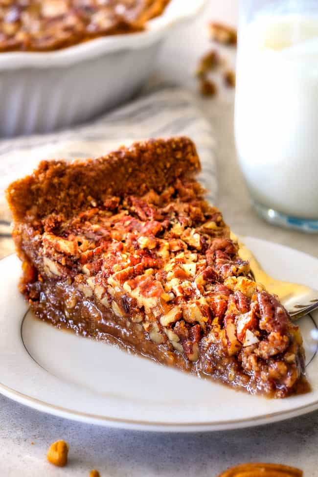 slice of homemade pecan pie on white plate