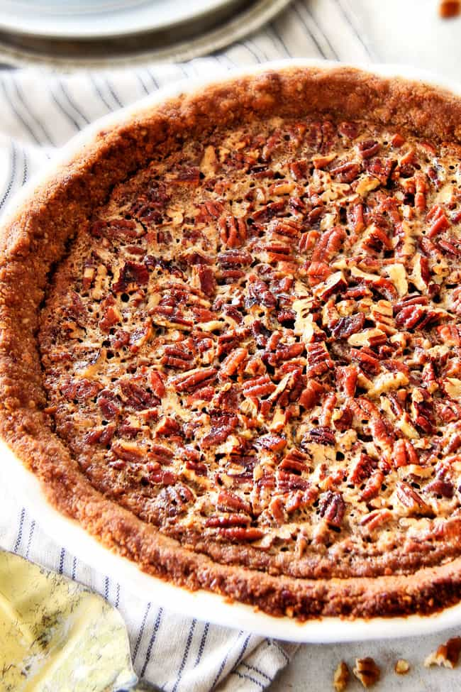 homemade pecan pie in white pie plate