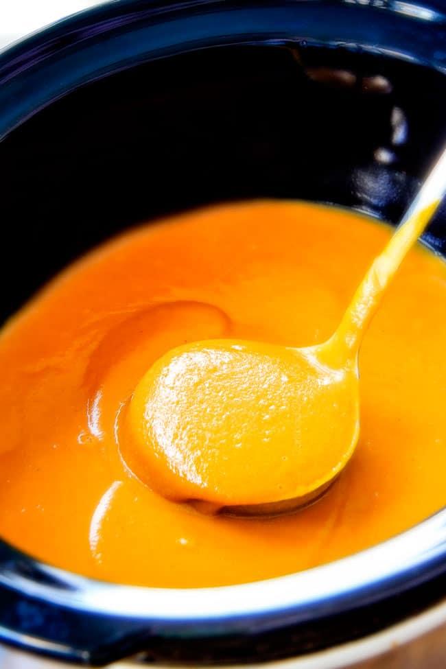 a ladle full of creamy Sweet Potato Soup
