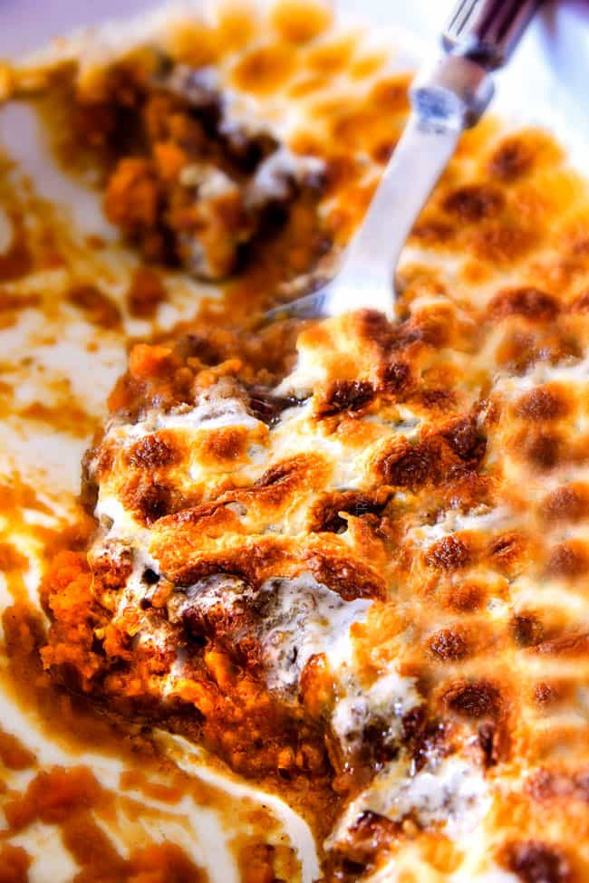 The best ever  Sweet Potato Casserole with Marshmallows AND buttery, brown sugar Pecan Topping!  This Sweet Potato Casserole has been our favorite recipe ever since we tasted it almost a decade ago and you will love that you can assemble it the night before Thanksgiving or Christmas!  No Thanksgiving table is complete without this comforting classic!