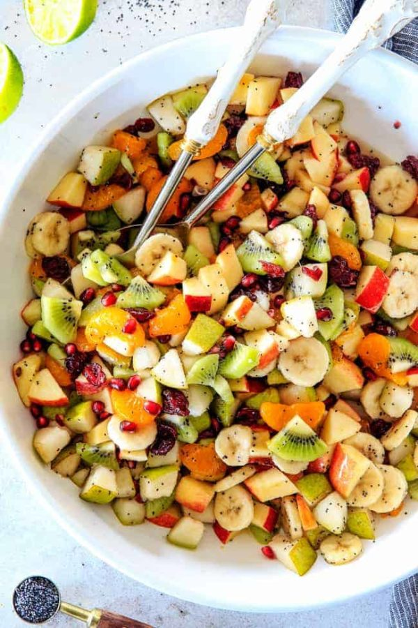 Irresistibly delicious, fresh and vibrant Winter Fruit Salad with Honey Lime Poppy Seed Vinaigrette is simple to whip together but can't stop eating delicious! It makes the perfect Thanksgiving or Christmas side!