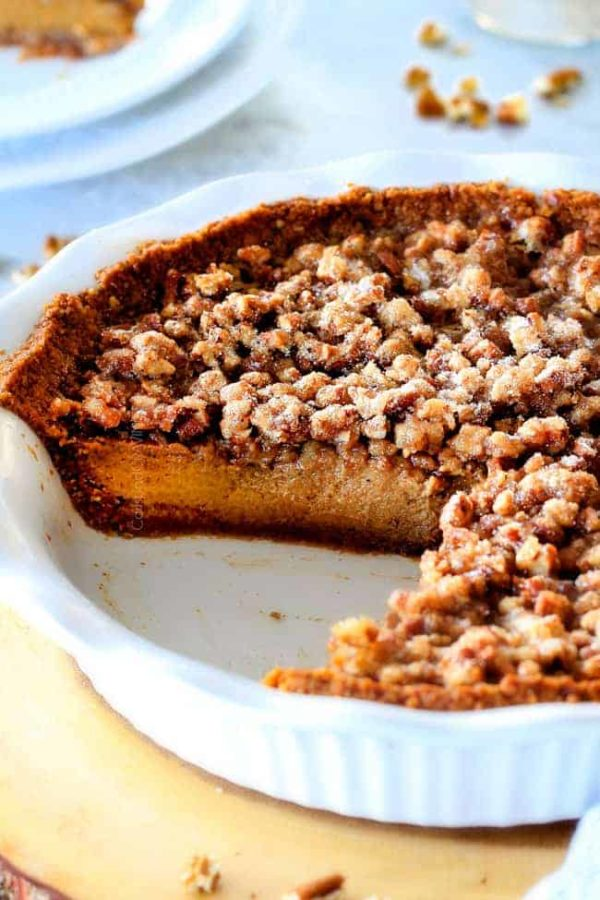 I will never go back to just Pumpkin Pie again! This Pumpkin PRALINE Pie is a Thanksgiving and Christmas must! Creamy pumpkin pie topped with crunchy, chewy brown sugar pecans for the perfect flavor and texture combination in every bite!