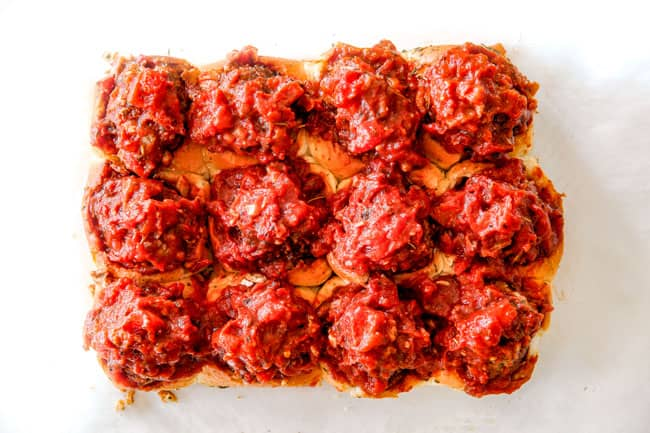 showing how to make meatball sliders by stuffing Italian meatballs into Hawaiian rolls
